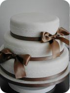 Ivory Lace and Bows Wedding Cake