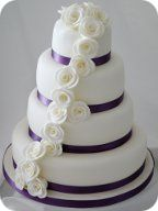 Purple and Ivory Rose Cascade Wedding Cake