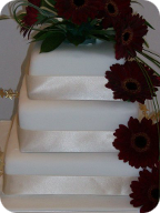 Three tier plain wedding cake
